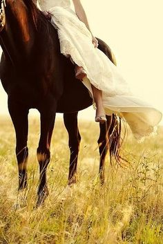 I always wanted a pic of me in my dress on my horse. Unfortunately it was raining on my wedding day.
