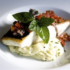 Roasted wild sea bass, mashed potatoes, tomatoes and fresh thyme