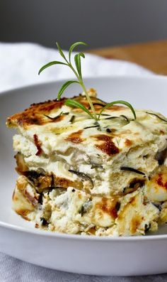 THREE-CHEESE, CHICKEN, MUSHROOM & ROSEMARY LASAGNA ~~~ really, really, really cool idea... she shares an option of using egg roll wrappers. mind melt here. boom! [feastingathome]