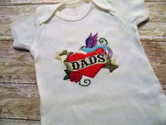 Sweet onesies for babies with two dads.