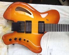 Victor Baker semi-hollow headless archtop