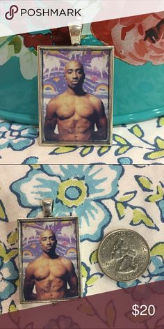 "Tupac & Lisa Frank purple unicorns pendant Express your unique sense of style with this Tupac necklace. The late rap artist shows off his abs against a Lisa Frank unicorn background. String it on a chain to wear as a necklace, or add it to your keyring for some extra flair. Brand is Totally Twitterpated--listed Anthro for exposure.  ❤️Glossy finish ❤️Antiqued silvertone pendant ❤️Measures 25mm x 35mm (approx. 1"" x 1.5"") ❤️Pendant only; chain NOT included ❤️Makes a unique gift! ❤️Price is…"