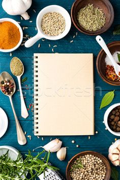 culinary background and recipe book with various spices on wooden table stock photo (c) yelenayemchuk (#7408165) | Stockfresh