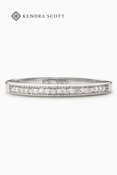 At once modern and totally classic, the Ensley 18k Sterling Silver Band Ring in White Diamonds signature detail is a row of petite pave diamonds that line the top of band for just the right amount of sparkle.