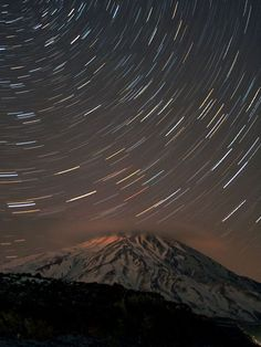 Stars whirl in the sky in a long-exposure photo of Mount Damavand in Iran. The mountain, which is part of the Elburz mountain range south of the Caspian Sea, is the highest volcano in Asia and the highest peak in the Middle East.