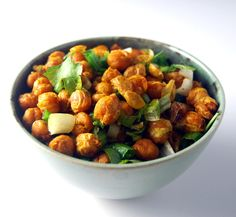 Chana Jor Garam is a spicy, tart, roasted chickpea snack from the belly of Mumbai. Toss in onions and leafy coriander for a delicious treat.