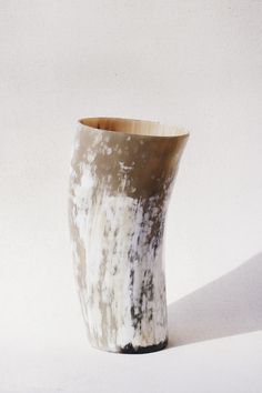 Modern, sleek, and chic, these cow horn vases are the perfect vessels for your floral favorites. All profits fund educational training programs for the women who handcraft Indego Africa's products. Ma