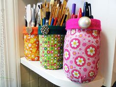Boring jars upcycled with scraps of fabric into useful (and pretty) storage containers