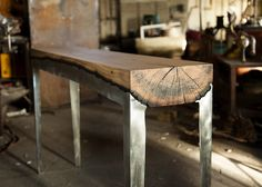 Tree trunks have been given the wow factor by Hilla Shamia via a simple furniture making process that involves casting natural wood with molten aluminum.