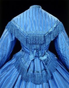 Machine-stitched day dress, V&A, c. 1862        What a bright dress you have! That's thanks to the new chemical dyes invented quite accidentally in 1856.