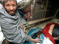We need to leave.     Mourner cries over children killed by rogue US soldier.