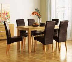 Elegant Small Dining Tables Sets With Black Leather Chair And Wooden Table Finished In Traditional Stylish Furniture In Bright Interior Room