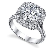 18K White Gold Cushion-shaped Diamond Sareen Engagement Ring. Beautiful Halo Cushion-shaped design with french pave set diamond side stones. Consists of 177 round brilliant diamonds (1.24ctw). The Ring maybe modified to hold different shapes and sizes. Prices may vary