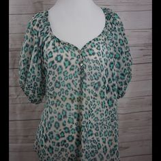 Chiffon (green) leopard print short sleeve blouse. Loser fitting small