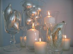 Choose to use all your silver and white ornaments for New Years Eve decor, once they are off the tree and surrounded by candles they look fresh and festive!