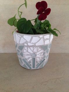 A personal favorite from my Etsy shop https://www.etsy.com/listing/225069391/handmade-mosaic-flower-pot-indoor