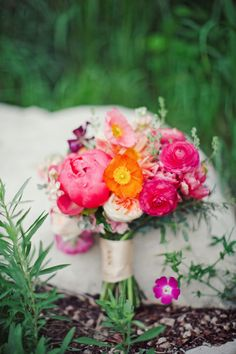 Bridal bouquet - Love the poppies!  And that it is bold, to stand out from the dress!  #DonnaMorganEngaged