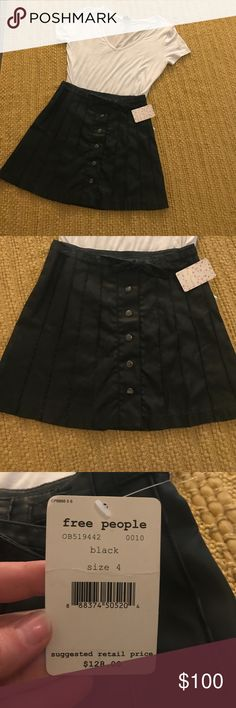 Free People size 4 NWT Free People size 4 NWT. Black with adorable belt Free People Skirts
