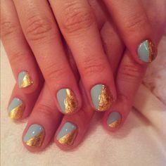 Gold and teal nail art