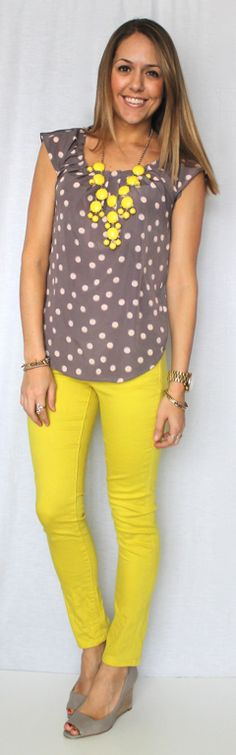 yellow statement necklace / yellow skinny jeans / gray and beige polka dot top / gray wedge heels