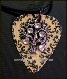Check out this item in my Etsy shop https://www.etsy.com/listing/230904617/guitar-pick-necklace-with-tree-of-life