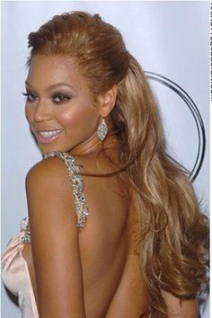 This is a sexy rockabilly hairstyle as Beyonce Knowles has her hair styled high on top and long at the back. The hair is brushed back at the sides and forehead, then styled back in place. This is a neat and clean hairstyle as there is no hair left out of place.The hair is cut long.This hair colour is a golden caramel brown.