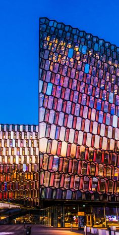 The Harpa Concert Hall features amazing architecture that is illuminated each evening with thousands of LED lights which move across the building. In Reykjavik, Iceland