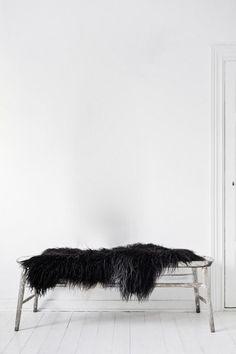 styling / entry . bedroom . bench seat + black sheepskin