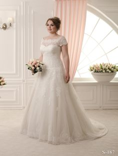 Plus Size Wedding Dress at WeddingDressFantasy #plussizeweddingdress #plussizedbridal #plussizebride