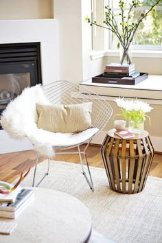 Bentwood Side Table // fireplace // eames chair // white living room