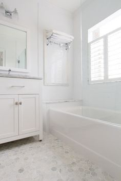 Small bathroom with Carrara marble hex tile on floor, ceramic subway tile on shower walls, marble counter top, marble bench seat, marble trimmin Carrara Marble Bathroom, Bathtub Tile, Bathroom Floor Tiles, Neutral Bathroom Tile, Bathroom Bench, Gold Bathroom, Bathroom Ideas, Tile Floor, The Farm
