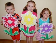 """Handprint flowers.  Photo can be put in the middle.  Bulletin board idea for """"We Bloomed in our Kindergarten!"""""""