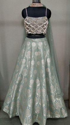 End to End Customization with Hand Embroidery & beautiful Zardosi Art by Expert & Experienced Artist That reflect in Blouse , Lehenga & Sarees Designer creativity that will sunshine You & your Party. Indian Lehenga, Indian Gowns, Indian Attire, Silk Lehenga, Indian Wear, Indian Bridal Outfits, Indian Designer Outfits, Designer Dresses, Indian Designers