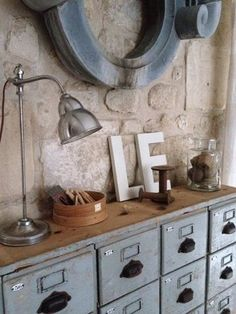 adding old distressed file cabinets to a wall could be interesting and cost effective
