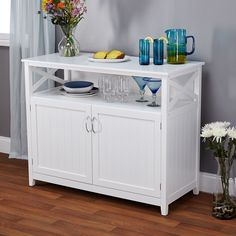 The Southport buffet is not only an attractive addition to your dining space but it has ample storage and an open shelf for displaying your favorite china or cook books. This buffet includes solid wood legs, finished in a clean white color.