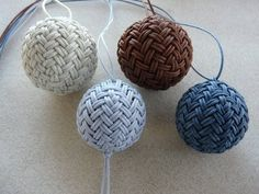 Four HPK (Herringbone Pineapple Knots) over wood balls, made into necklaces for casual wear with jeans.