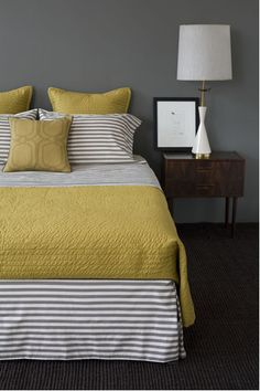 Grey wall - yes, but I like the stripes on the bedding.