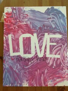 "DIY Toddler Finger Paint. Use painters tape to spell out ""LOVE"" and then let your little one have fun."