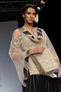 Cream Resham Choli with Zardosi Yoke worn with Midnight Blue Kalidar Lehenga and Champagne Tulle Dupatta. SHOP THIS LOOK: http://www.payalsinghal.com/search/alecia-lehenga