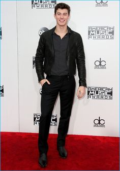 Wearing a leather jacket, Shawn Mendes goes semi-casual in Giorgio Armani for the 2016 American Music Awards.