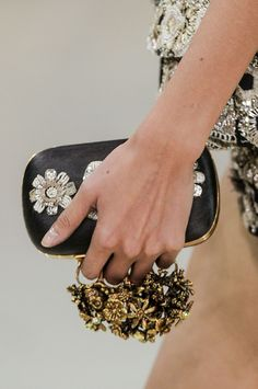 alexander mcqueen bag  i'm looking more at these interesting rings