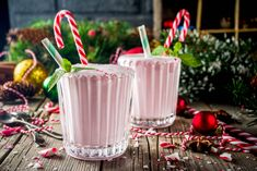 Christmas sweet cold drink, Homemade Peppermint Candy Cane Milkshake in two glasses, old wooden background with xmas decorations copy space , Protein Shake Recipes, Protein Shakes, Peppermint Candy Cane, Xmas Decorations, Cold Drinks, Milkshake, Birthday Candles, Wooden Background, Holiday
