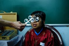 A Bhutanese child having his vision tested by the Sight For All team