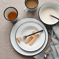 Enamelware Dinnerware Set - Black rim on white set.  Get a number of plates and bowls. They are super cute, durable and will go with the black/white/grey theme.