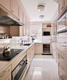 After replacing the kitchen's linoleum flooring and metal cabinets, Hampton installed a cooktop and ovens by Gaggenau, Waterworks sink fittings, and a Sub-Zero wine refrigerator | archdigest.com