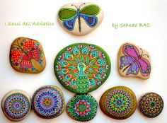 My new #paintedstone peacock with butterfly/dragonflies & colorful mandalas https://www.facebook.com/ISassiDelladriatico