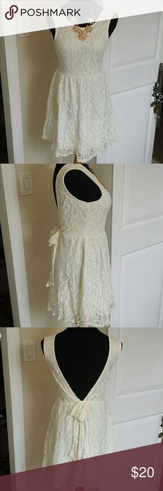 NWT cream lace open back bow back dress Gorgeous flirty little open back dress. Wear with a brightly colored bandeau or bralette to show off open back. Tagged size L but it's a juniors fits a women's M. Feel free to make an offer! Dresses
