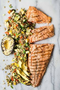 Take your tastebuds on a journey with this easy king salmon grilled with salt and pepper and served with a green lentil and grilled vegetable salad.