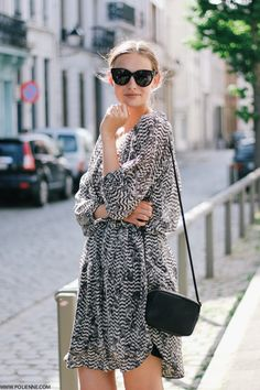 Paulien Is Wearing Black, White And Grey Silk Dress Designed By Isabel Marant For H&M, Black Bag From H&M And Sunglasses From Celine