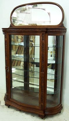 Serpentine Door Carved Oak China Cabinet with Mirrored Splash